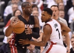 Miami Heat's Dwyane Wade controls the ball as Toronto Raptors' Kyle Lowry (7) defends during game one second round NBA playoff basketball action in Toronto on Tuesday, May 3, 2016. (Frank Gunn / THE CANADIAN PRESS)