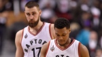 Toronto Raptors' Kyle Lowry (7) and Jonas Valanciunas walks towards the bench late in regulation time game one second round NBA playoff basketball action against the Miami Heat in Toronto on Tuesday, May 3, 2016. (THE CANADIAN PRESS/Frank Gunn)