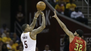 Cleveland Cavaliers guard J.R. Smith puts up a 3-point shot against Atlanta Hawks forward Mike Scott in the first half during Game 2 of a second-round NBA basketball playoff series in Cleveland on Wednesday, May 4, 2016. (AP / Tony Dejak)
