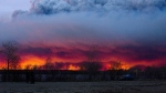 A wildfire moves towards the town of Anzac from Fort McMurray, Alta., on Wednesday May 4, 2016. (Jason Franson / THE CANADIAN PRESS)