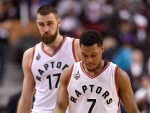 """Toronto Raptors' Kyle Lowry (7) and Jonas Valanciunas walks towards the bench late in regulation time game one second round NBA playoff basketball action against the Miami Heat in Toronto on Tuesday, May 3, 2016. Lowry is hoping to rediscover his love of playing to overcome his """"mind-boggling"""" slump. THE CANADIAN PRESS/Frank Gunn"""