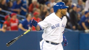 Toronto Blue Jays Edwin Encarnacion tosses his bat after hitting a three run home run against the Texas Rangers in the third inning of thier American League MLB baseball game in Toronto on Thursday, May 5, 2016. THE CANADIAN PRESS/Fred Thornhill