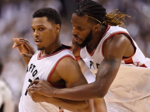 Toronto Raptors' DeMarre Carroll celebrates with teammate Kyle Lowry (7) after Lowry made a key basket late in the game during NBA playoff basketball action against the Miami Heat in Toronto on Thursday, May 5, 2016. (The Canadian Press/Frank Gunn)