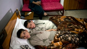 Abdul Rasheed, 9, front, and Shoaib Ahmed, 13, lie in a bed at a hospital in Islamabad, Pakistan on Thursday, May 5, 2016. (AP /B.K. Bangash)