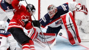 Canada's Brad Marchand, left, attacks the net of Keith Kinkaid of the United States during the Hockey World Championships Group B match in St.Petersburg, Russia, on May 6, 2016. (Dmitri Lovetsky / AP)