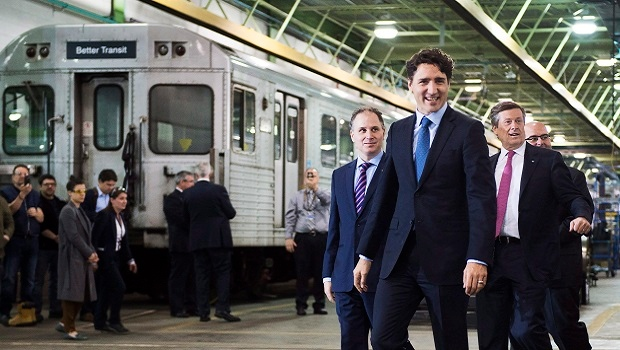 Prime Minister Justin Trudeau, centre, and Toronto Mayor John Tory, right, visit the Greenwood Subway Yard in Toronto on Friday, May 6, 2016. (THE CANADIAN PRESS/Nathan Denette)