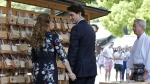 Canadian Prime Minister Justin Trudeau, centre, and wife Sophie Gregoire Trudeau, left, leave after hanging wooden plaques called 'ema' written by them, during their visit to the Meiji Shrine, in Tokyo, Japan, on Tuesday, May 24, 2016. (AP / Shuji Kajiyama)