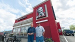Sharon and Warren Solie stand in front of a KFC restaurant in Weyburn, Saskatchewan on Tuesday May 24, 2016. An all-you-can-eat buffet at the Kentucky Fried Chicken in Weyburn, Saskatchewan is one of the last remaining smorgasbords still being served at the fast food chain in Canada. (Michael Bell / The Canadian Press).