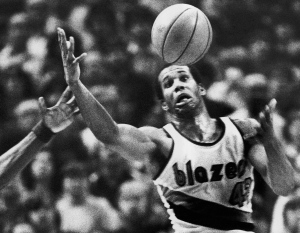 In this Dec. 25, 1979, file photo, Portland Trail Blazers' Kermit Washington gains control of a loose ball during an NBA basketball game against the Golden State Warriors in Portland, Ore. (AP / Jack Smith)