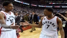 Toronto Raptors' DeMar DeRozan and teammate Toronto Raptors guard Kyle Lowry (7) celebrate winning over the Cleveland Cavaliers in Eastern Conference final NBA playoff basketball action in Toronto on Monday, May 23, 2016. (THE CANADIAN PRESS/Frank Gunn)