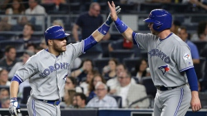 Toronto Blue Jays' Russell Martin, left, is greeted by Justin Smoak after hitting a two-run home run against the New York Yankees in the seventh inning Wednesday, May 25, 2016, in New York. (Julie Jacobson/ The Associated Press)