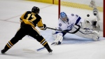 Pittsburgh Penguins' Bryan Rust misses a shot on Tampa Bay Lightning goalie Andrei Vasilevskiy during the third period of Game 7 of the NHL hockey Stanley Cup Eastern Conference finals in Pittsburgh in Thursday, May 26, 2016. (AP / Gene J. Puskar)