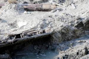 A portion of a shipwreck from the 1800s that has been uncovered during construction in the Seaport District is seen, Wednesday, May 25, 2016, in Boston.  (AP Photo/Elise Amendola)