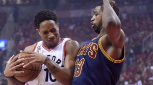 Toronto Raptors guard DeMar DeRozan covers the ball as Cleveland Cavaliers guard Tristan Thompson defends during first half Eastern Conference final NBA playoff basketball action in Toronto on Friday, May 27, 2016. THE CANADIAN PRESS/Frank Gunn