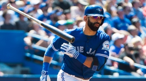 Toronto Blue Jays right fielder Jose Bautista (19) tosses his bat aside after hitting a infield ground out against the Boston Red Sox during fifth inning AL baseball action in Toronto on Saturday, May 28, 2016. THE CANADIAN PRESS/Nathan Denette