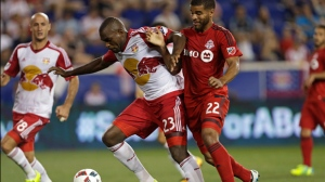 New York Red Bulls Ronald Zubar (23) and Toronto FC forward Jordan Hamilton (22) battle for the ball during the second half of an MLS soccer game on Saturday, May 28, 2016, in Harrison, N.J. (AP Photo/Adam Hunger)