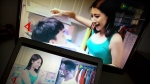 "Two scenes from a detergent ad by Shanghai Leishang Cosmetics Ltd. Co. are shown on computer screens in Beijing, Sunday, May 29, 2016. The Chinese laundry detergent maker apologized late Saturday for the harm caused by the spread of an ad in which a black man ""washed"" by its product was transformed into a fair-skinned Asian man. (AP / Mark Schiefelbein)"