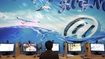In this file photo, an Iranian man surfs the Internet at a cafe in Tehran, Iran, Tuesday, Sept, 17, 2013. (AP Photo / Ebrahim Noroozi)
