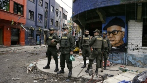 Police officers stand in the area known as El Bronx in downtown Bogota, Colombia on Monday, May 30, 2016. (AP / Fernando Vergara)
