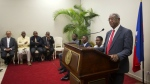 The president of the special verification commission Francois Benoit pauses during a ceremony in the national palace, in Port-au-Prince, Haiti on Monday, May 30, 2016. (AP / Dieu Nalio Chery)