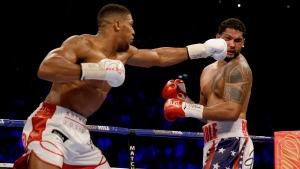 British boxer Anthony Joshua, left, fights U.S. boxer Dominic Breazeale during their IBF heavyweight title bout at the O2 Arena in London, Saturday, June 25, 2016. (Matt Dunham/AP Photo)