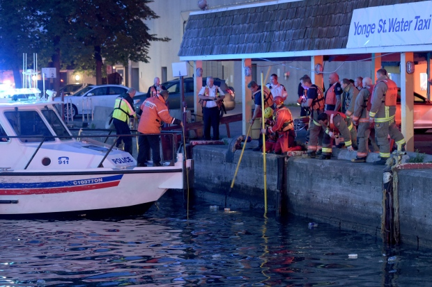 A man pulled from the water near the Jack Layton Ferry Terminal has been rushed to hospital in life-threatening condition. (Andrew Collins/ CP24)