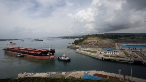 The Malta flagged cargo ship named Baroque, a post-Panamax vessel, arrives to the Agua Clara locks on a test of the newly expanded Panama Canal in Agua Clara, Panama, Friday, June 24, 2016. The canal's expansion project will be officially inaugurated on Sunday. (AP / Moises Castillo)