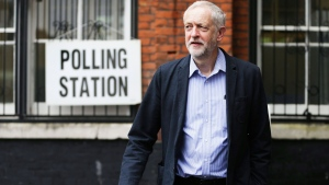 Britain's Labour Party leader Jeremy Corbyn smiles as he arrives to cast his vote in the EU referendum at a polling station in Islington, London Thursday June 23, 2016 (Daniel Leal-Olivas / PA via AP)