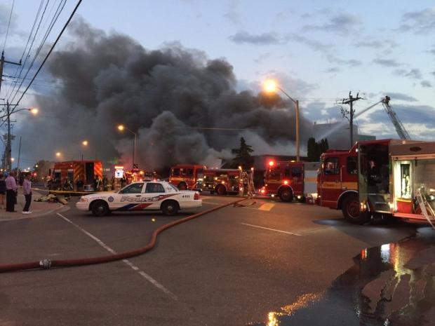 Firefighters battle a three-alarm blaze at an electronics store in the city's Golden Mile neighbourhood Monday June 27, 2017. (@ItsJonOrlando /Twitter)