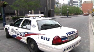 Police were on the scene to close down two roads in Yorkville after receiving reports from the Four Seasons Hotel that there was a cracked window in a residential unit.