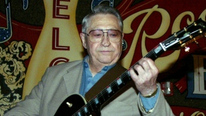 Scotty Moore, a former guitarist for Elvis Presley, is seen playing music at the 2nd annual Ponderosa Stomp in New Orleans on April 30, 2003. (AP / Judi Bottoni)