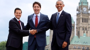 Prime Minister Justin Trudeau (centre), Mexican President Enrique Pena Nieto (left) and U.S. President Barack Obama (right) take part in a family photo at the North American Leaders' Summit in Ottawa, Wednesday, June 29, 2016. (Fred Chartrand / THE CANADIAN PRESS)