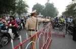 A police officer directs traffic on a Hanoi street in this file image from Thursday, Nov. 16, 2006. (AP / Aaron Favila)