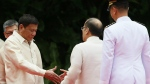 New Philippine President Rodrigo Duterte, left, and outgoing President Benigno Aquino III shake hands during inauguration ceremony at Malacanang Palace grounds in Manila, Philippines on Thursday, June 30, 2016. (AP / Bullit Marquez)