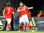 Wales' Sam Vokes, center, celebrates after scoring his side's third goal during the Euro 2016 quarterfinal soccer match between Wales and Belgium, at the Pierre Mauroy stadium in Villeneuve d'Ascq, near Lille, France, Friday, July 1, 2016. (AP / Frank Augstein)