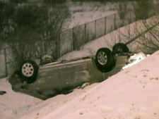 A car is pulled out of the ditch after a single-car collision on the Hwy 427 near Finch Avenue on Wednesday, Jan. 28, 2009.