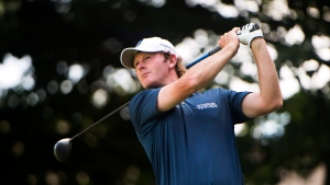 Brandt Snedeker, of the United States, tees off on the tenth hole at the 2016 Canadian Open in Oakville, Ont., on Saturday, July 23, 2016. (THE CANADIAN PRESS/Nathan Denette)