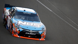 Kyle Busch (18) heads into the first turn during the NASCAR Xfinity auto race at Indianapolis Motor Speedway in Indianapolis, Saturday, July 23, 2016. (AP Photo/Michael Conroy)