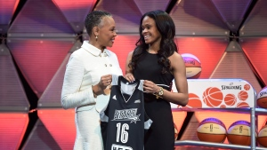 Connecticut's Moriah Jefferson, right, and WNBA President Lisa Borders hold a San Antonio Stars jersey after Jefferson was selected with the second pick in the WNBA basketball draft in Uncasville, Conn. on April 14, 2016. (Cloe Poisson/Hartford Courant via AP, File)