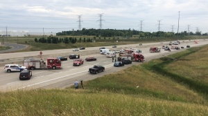 Police shut down Highway 407 westbound at Mississauga Road while they investigated the scene of a fatal collision in Brampton on July 24, 2016.