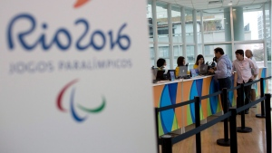 A kiosk sells Olympic and Paralympic Games tickets at a shopping mall in Rio de Janeiro, Brazil, on Monday, June 20, 2016. (AP Photo/Silvia Izquierdo)