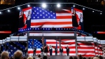 Youngest delegate 17-year-old Clarissa Rodriguez of Texas and the oldest delegate 93-year-old Ruby Gilliam of Ohio deliver the pledge of Allegiance during the first day of the Democratic National Convention in Philadelphia , Monday, July 25, 2016. (AP Photo/Carolyn Kaster)