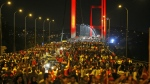Pro-government supporters protest against the attempted coupon Istanbul's iconic Bosporus Bridge on Thursday, July 21, 2016. (AP / Emrah Gurel)