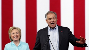 Tim Kaine speaks as Hillary Clinton listens in Miami on July 23, 2016. (Mary Altaffer / AP)