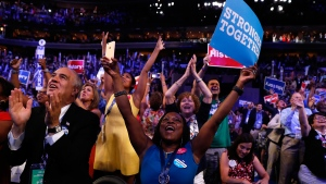 Delegates cheer as Democratic Presidential candidate Hillary Clinton appears on the screen at the Democratic National Convention in Philadelphia, on July 26, 2016. (Carolyn Kaster / AP)
