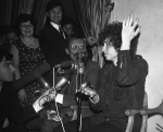 In this May 22, 1966 file photo, Bob Dylan gestures during a press conference in Paris, France. Dylan's tumble from his Triumph in Woodstock, N.Y., 50 years ago on July 29, 1966, was the most analyzed motorcycle crash in pop-culture history. But for all its importance, details surrounding the crash remain foggy. (AP Photo/Pierre Godot, File)