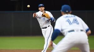 Toronto Blue Jays' Josh Donaldson throws to Justin Smoak at first base during the third inning of their MLB baseball game against the Baltimore Orioles on Friday, July 29, 2016 in Toronto. THE CANADIAN PRESS/Jon Blacker