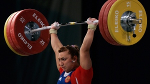 """In this Saturday, April 10, 2010 file photo, Russia's Nadezhda Evstyukhina successfully lifts a weight in the Women's 75kg category, during the European Weightlift in Minsk, Belarus. Russian state news agency Tass says the """"B'' samples of two Russian women's weightlifting medalists from the 2008 Beijing Olympics have come back positive for steroids. Marina Shainova, who won silver in the 58-kilogram class, and Nadezhda Evstyukhina, bronze medalist in the 75-kg division, were among 10 Russian medalists from Beijing who reportedly tested positive last month in IOC reanalysis of their stored samples. (Dmitry Brushko, FILE/AP Photo)"""