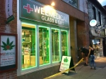 Police tape can be seen surrounding WeeMedical on Queen Street West on Tuesday, Aug. 23, 2016. (CP24/Cristina Tenaglia)
