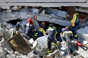 Rescuers search for victims beneath destroyed houses following Wednesday's earthquake in Pescara Del Tronto, Italy, Thursday, Aug. 25, 2016. (AP Photo/Gregorio Borgia)